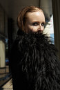 Beautiful woman model in fashion black warm jacket with fluffy fur Stock Photo