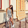 Beautiful woman model on a vintage bike outdoor Royalty Free Stock Photo