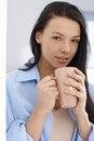 Beautiful woman with morning tea young drinking Royalty Free Stock Photo