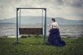 image photo : Beautiful woman on nature and swing.