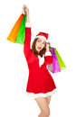 Beautiful woman in new year costume with shopping bags colorful isolated on white Royalty Free Stock Image