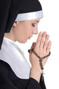 Beautiful woman nun praying with rosary isolated on white background Stock Photography