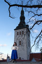 Beautiful woman in old town of tallinn twilight estonia Stock Image