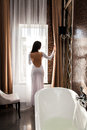 Beautiful woman open the curtain and preparing to take a bath Royalty Free Stock Image