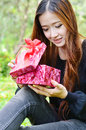 Beautiful woman open a gift box and smiling face Royalty Free Stock Photography
