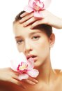 Beautiful woman with a orchid flowers young Stock Photography