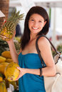 Beautiful woman outdoor lifestyle portrait in a fruit market Stock Photos