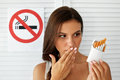 Beautiful Woman With Pack Of Cigarettes And No Smoking Sign Royalty Free Stock Photo