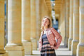 Beautiful woman in Palais Royale in Paris Royalty Free Stock Photo