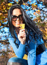 Beautiful woman in a park  in the autumn season Stock Images