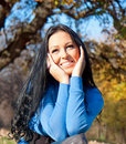 Beautiful woman in a park  in the autumn season Stock Photography