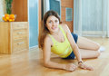 Beautiful woman on parquet having rest at home Stock Image
