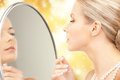 Beautiful woman with pearl beads and mirror picture of Stock Photo