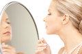 Beautiful woman with pearl beads and mirror picture of Stock Photography