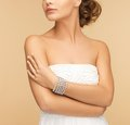 Beautiful woman with pearl earrings and bracelet beauty jewelery concept Stock Photos
