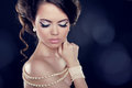 Beautiful woman pearl necklace bared shoulders studio photo Stock Photo