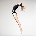 Beautiful woman with perfect slim body and long legs jumping - f Royalty Free Stock Images