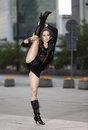 Beautiful woman performing acrobatics in the city Royalty Free Stock Photography