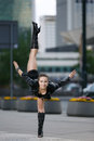 Beautiful woman performing acrobatics in the city Stock Image