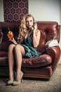 Beautiful woman phoning sitting on the sofa Royalty Free Stock Photo
