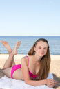 Beautiful woman in pink bikini lying on the beach young Stock Photos