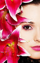 Beautiful woman with pink lilies Stock Photos