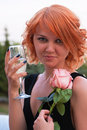 Beautiful woman with pink rose drinking champagne Royalty Free Stock Photos