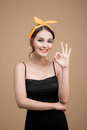 Beautiful woman pinup style portrait. Asian woman hands gesture Royalty Free Stock Photo