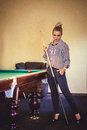 Beautiful woman play billiard Royalty Free Stock Photo