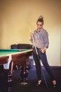 Beautiful woman play billiard Royalty Free Stock Photo