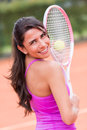 Beautiful woman playing tennis and holding a racket Stock Image