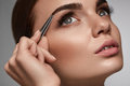 Beautiful Woman Plucking Eyebrows. Beauty Brows Correction Royalty Free Stock Photo