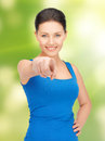 Beautiful woman pointing her finger bright picture of Royalty Free Stock Image