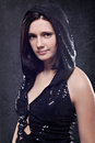Beautiful woman portrait in hood on dark background Royalty Free Stock Photos