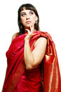 Beautiful woman portrait of in red sari isolated against a white backdrop Stock Photo
