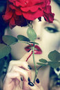 Beautiful woman portrait with rose