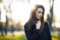 Beautiful woman portrait in sun light on sunset time in city par Royalty Free Stock Photo