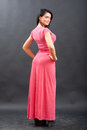 Beautiful woman posing in long dress Stock Image