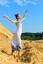 Beautiful woman posing at the sand place. Royalty Free Stock Photos