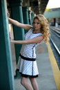 Beautiful woman posing sexy in nyc subway station outside with sunset light Royalty Free Stock Images