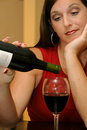 Beautiful woman pouring wine Stock Photo