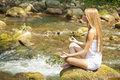 Beautiful Woman Practive Yoga On River In Nature Royalty Free Stock Photo
