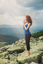 Beautiful woman praying in mountain landscape enjoy the view the mountains and Royalty Free Stock Photo