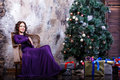 Beautiful woman in purple elegant evening dress. Royalty Free Stock Photo