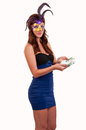 Beautiful woman in purple mysterious venetian mask posing young with money her hands Stock Photography