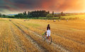 Beautiful woman pushes old red bike in a wheat field Royalty Free Stock Photo