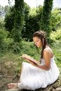 Beautiful woman reading a book in forest, nature Stock Photography