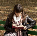 Beautiful woman reading book in park Stock Photos