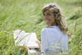 Beautiful Woman Reading Outdoors Royalty Free Stock Image