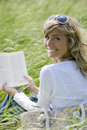 Beautiful Woman Reading Outdoors Royalty Free Stock Photos